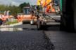 Фінішує укладання другого шару покриття на ремонтованій ділянці М-19
